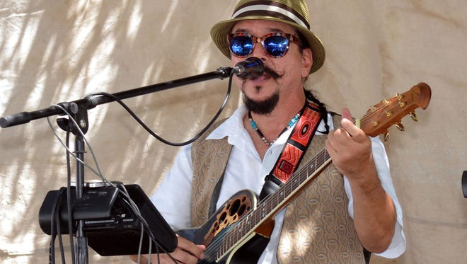 Local musician Randy Granger provided some live entertainment at this weekend's Franciscan Festival of the Arts.  Photo taken 9/3/16.