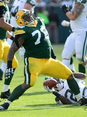 Green Bay Packers defensive tackle Mike Daniels (76) celebrates a tackle for a loss in the first quarter. Green Bay Packers defeated the New York Jets 31-24 at Lambeau Field.