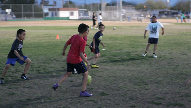 Members of Liverpool  soccer team practice at Mecca Elementary School/Mecca Community Center field on Thursday, March 15, 2012 in Mecca..(Richard Lui The Desert Sun)