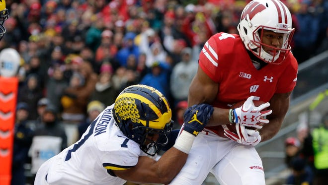 A.J. Taylor's 24-yard touchdown reception in front of  Michigan's Khaleke Hudson was the go-ahead score Saturday in Wisconsin's 24-10 victory.
