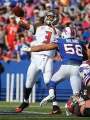 Tampa Bay quarterback James Winston looks deep while