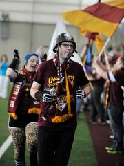 Detroit FC supporters Drew Gentry, front, aka Sgt. Scary, and Amy Michelle, aka Banshee, get the crowd going.