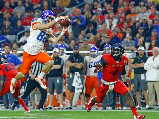 Boise State Broncos wide receiver Thomas Sperbeck (82) makes a catch in front of Arizona Wildcats safety Tellas Jones (1) in the 2nd quarter of the Vizio Fiesta Bowl Wednesday, Dec. 31,  2014 in Glendale, Ariz.