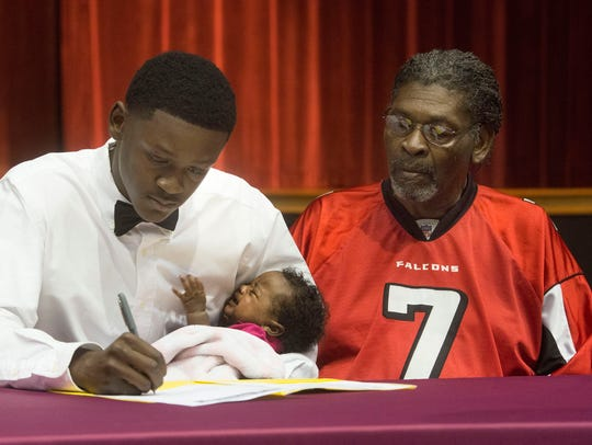 Pensacola High School Senior, Robert Reeves, III, signs