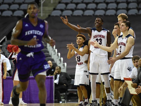 The USI bench gives some love to the team on the floor as perennial rivals Kentucky Wesleyan College and University of Southern Indiana play in the Small College Basketball Hall of Fame Classic at the Ford Center Saturday, November 4, 2017.