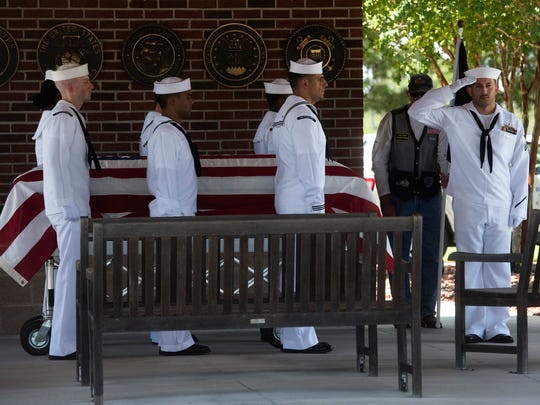 A Navy Honor Guard delivers the remains of John Schoonover; a sailor killed on the USS Oklahoma during the Japanese attack on Pearl Harbor to Barrancas National Cemetery for final burial on board Pensacola Naval Air Station, Tuesday, June 26, 2018. DNA was used to identify the remains nearly 80-years after his death.