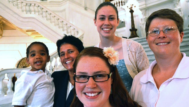 In this July 9, 2013 file photo, the Whitewoods, left to right, Landon, Susan,  Abbey, Katie, and Deb, pose together after a news conference to announce that Deb and Susan are the lead plaintiffs in a lawsuit seeking to overturn a state law effectively banning same-sex marriage in Pennsylvania, in Harrisburg, Pa.  Pennsylvania's ban on gay marriage was overturned Tuesday May 20, 2014 by a federal judge in a decision that makes same-sex marriage legal throughout the Northeast. (AP Photo/Marc Levy)