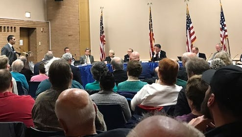 Residents jammed the Brighton board room on May 10 to voice their thoughts on a proposed Monroe Avenue development.