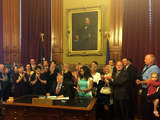 Gov. Terry Branstad signs a bill on Friday, May 5, 2017 that requires a 72-hour waiting period for abortions at any stage of pregnancy and which bans most abortions after 20 weeks.