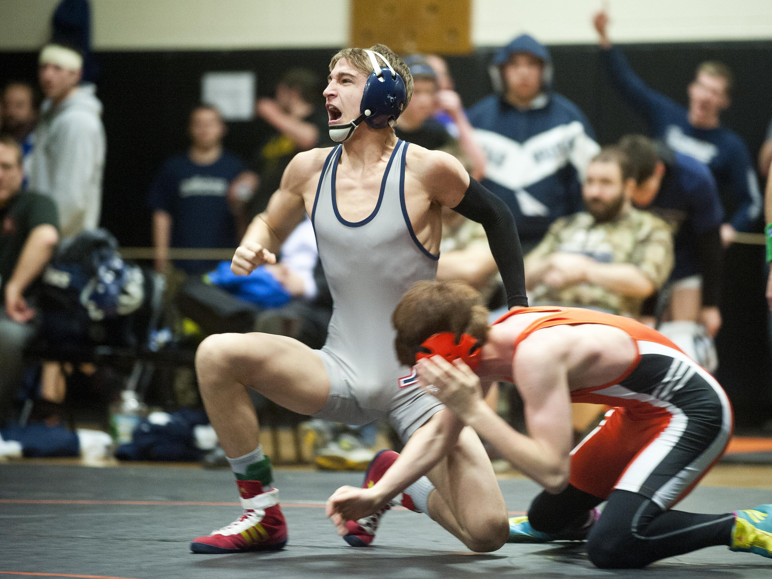 Mount Anthony's Calvin Call reacts after his first-period pin of Middlebury's Nathan Gebo in the 113-pound state championship at Middlebury on Saturday night.