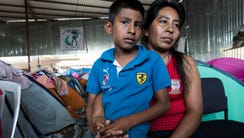 Manuela Candelaria Solano holds her 11-year-old son