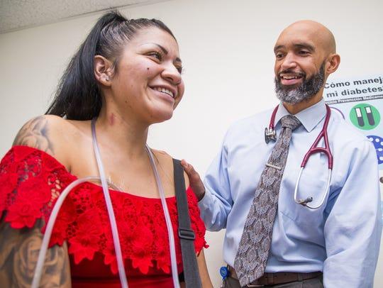 Dr. Maurice Lee examines patient Yoana Nava Lugo, 27,