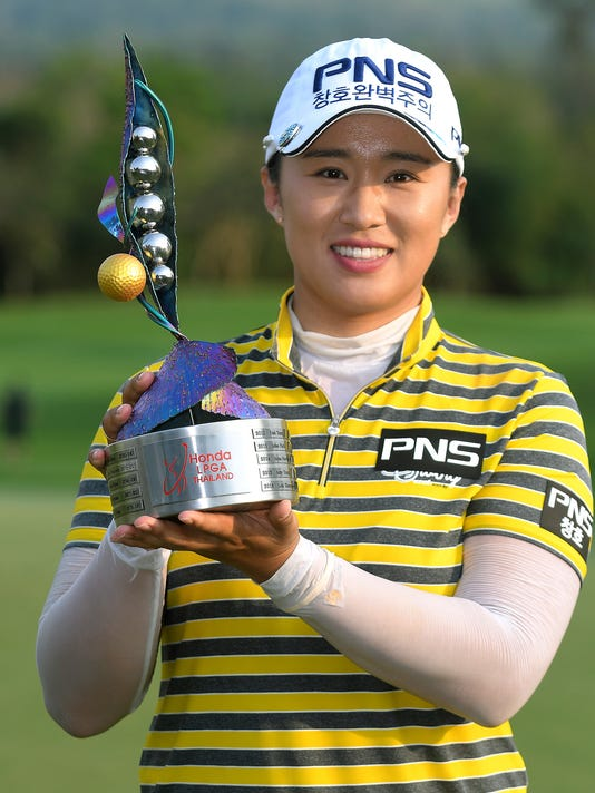 Amy Yang of South Korea poses with her trophy for photographers during the award ceremony after winning the LPGA Thailand golf tournament in Pattaya, southern Thailand, Sunday, Feb. 26, 2017.  Yang rarely wavered with a big lead during the final round of the tournament, shooting a 4-under 68 to win by five strokes Sunday. (AP Photo/Nuttapong Meelung )