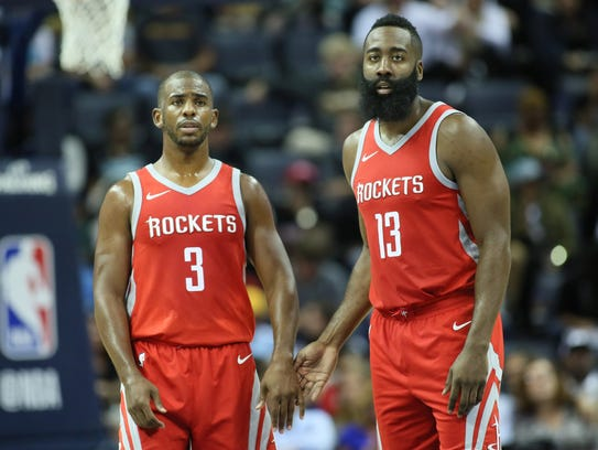 Houston Rockets guard Chris Paul (3) and James Harden