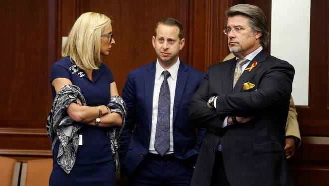Sen. Lauren Book, D-Plantation, left to right, Rep. Jared Moskowitz, D-Coral Springs, and Sen. Gary Farmer, D-Fort Lauderdale, on the Senate floor Monday as the school safety bill inspired by the shooting at Marjory Stoneman Douglas High School is debated.