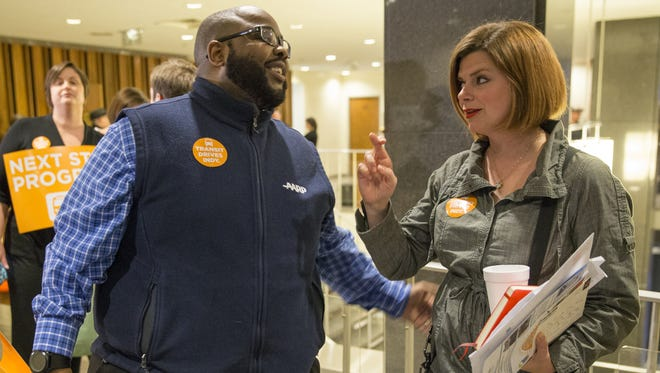 City-County Council member Colleen Fanning,  right, chats with Mandla Moyo before a Feb. 27 vote on an income tax increase to pay for an expanded transit system.