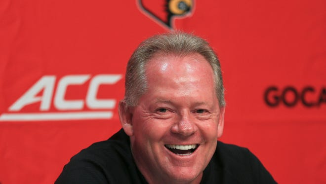 Bobby Petrino laughs during his Wednesday press conference about the upcoming season. He said he finds it 'a little comical' that some coaches are recruiting players as young as nine-years-old.