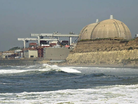 Pacific surf rolls in under the nuclear reactors of the San Onofre Nuclear Generating Station in northern San Diego County on April 25, 2001.