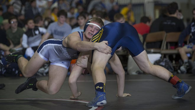 Collingswood's Nick Barnes works for a takedown on Delaware Valley's Shawne Ramsby during their  182-pound bout in Sunday's Group 2 state semifinal in Toms River.