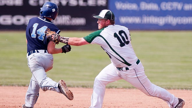 Enosburg's Alec Burns, right, tags Randolph's Hunter Brassard on his way to second during a play in the seventh inning of the Division III baseball state championship game on Saturday at Centennial Field. Brassard was ruled safe, but Enosburg held on for a 3-1 win.