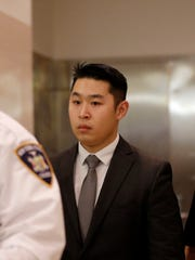 New York City rookie police officer Peter Liang, center,