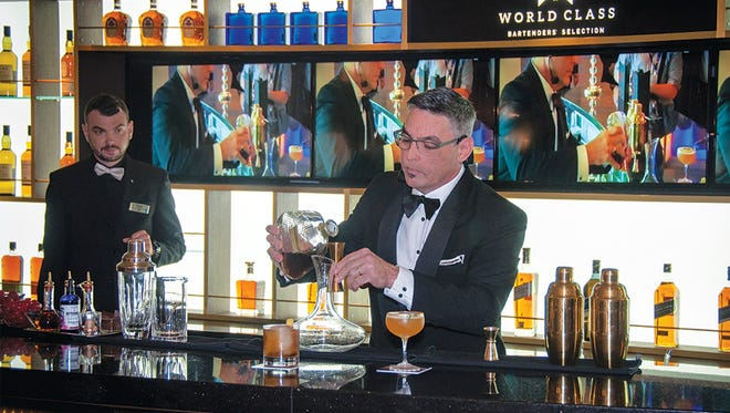 A barman mixes a drink on a Celebrity Cruises ship.