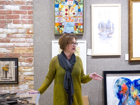 The Rumjahn Gallery and Framery owner Tina Rumjahn discusses plans with manager Lindsay Meece concerning their grand opening Friday.