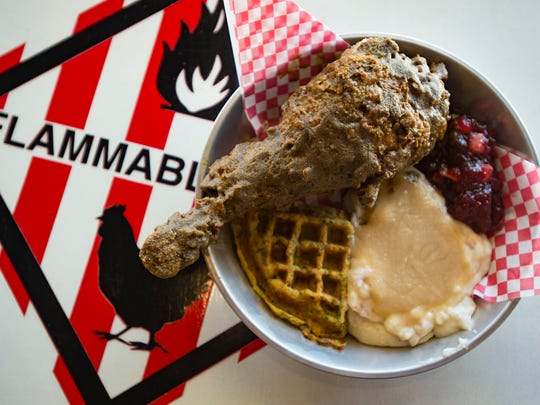 A Nashville hot turkey leg is served with mashed potatoes, cranberry sauce and a waffle made with Thanksgiving stuffing at Music City Hot Chicken in Fort Collins.