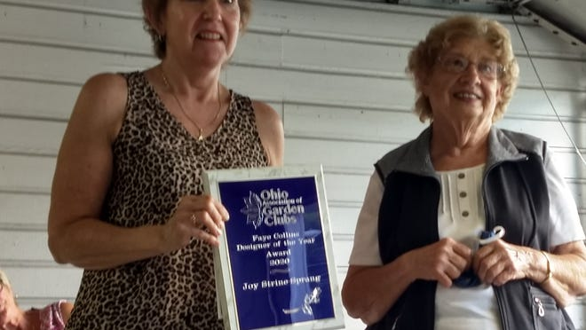 Joy Strine-Spreng of Wooster is presented the Faye Collins Designer of the Year award by JoAnne Graham of Mount Vernon, Ohio Association of Garden Clubs design chairman, at the Aug. 17 meeting of the Gardener's Guild of Loudonville.