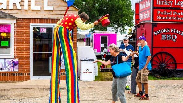 Kristen Garlow Piper collects colorful characters during the Kansas State Fair.