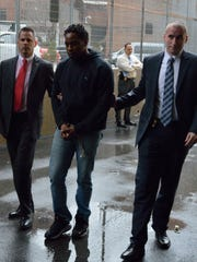 Sheppard Adeghe is taken into custody in Yonkers, where