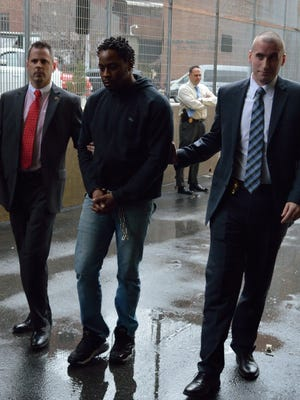 Sheppard Adeghe is taken into custody in Yonkers, where he is accused of fatally shooting a man on Aug. 10, 2016.