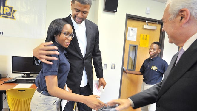 Both Jiyah Pitt, 16, with Jalen Rose and Doug Ross, president of American Promise Schools, and Teion Howard, 16, say new graduation requirements will help prepare them for the challenges of college.