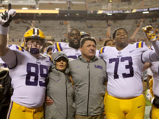 LSU snapper Trey Gallman (89), offensive lineman Adrian Magee (73), coach Ed Orgeron and his wife, Kelly Orgeron, celebrate after LSU defeated Tennessee 30-10 during an NCAA college football game Saturday, Nov. 18, 2017, in Knoxville, Tenn. (C.B. Schmelter/Chattanooga Times Free Press via AP)