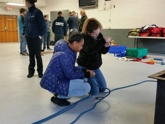 Public Safety cadets Ciani Lindsay and Gina Dych practice their rope skills at the Delaware State Fire School.