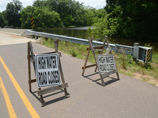 ANI Rioglette Road Signs near the bridge on Rigolette Road in Pineville warn motorists of high water. .-Melinda Martinez/The Town Talk