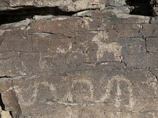 Native American petroglyphs are visible on rock surfaces
