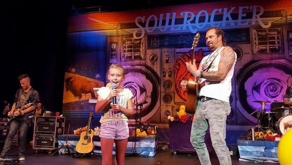 Malia (age 8) sings with Michael Franti. Malia has her own sticker campaign titled Just Be Nice.