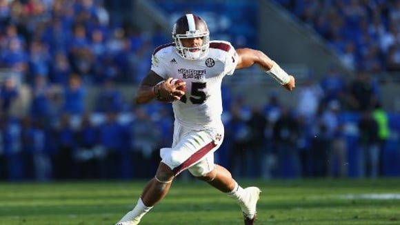 Mississippi State quarterback Dak Prescott runs against Kentucky.