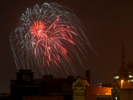 Fireworks explode over the city skyline to celebrate First Night Burlington on Dec. 31.