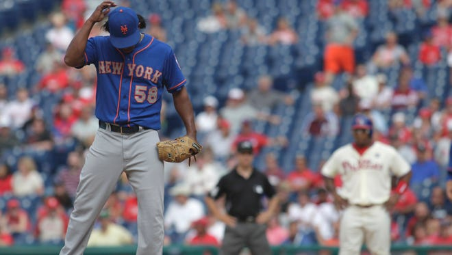 Mets pitcher Jenrry Mejia stands on the mound after Philadelphia's Marlon Byrd hit an RBI single in the ninth inning on Sunday, in Philadelphia. The Phillies won 7-6.