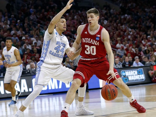 Indiana's Collin Hartman (30) tries to get past North Carolina's Justin Jackson (44) during the first half of an NCAA college basketball game in the regional semifinals of the men's NCAA Tournament, Friday, March 25, 2016, in Philadelphia. (AP Photo/Chris Szagola)
