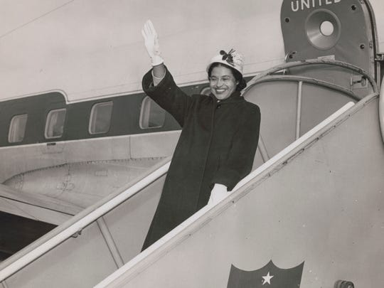 Parks acknowledges admirers from a United Air Lines jetway in Seattle in 1956.
