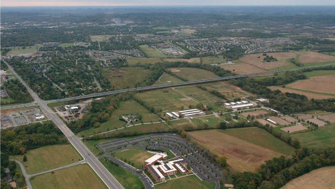 This 2013 file photo rendering looking south shows the proposed Mack Hatcher Parkway heading toward Highway 96 West (right) and away from the current intersection of Hillsboro Road. The road would cross the Harpeth River twice as the waterway loops around Brownland Farm. Christ Community Church is at the bottom center of the photo.