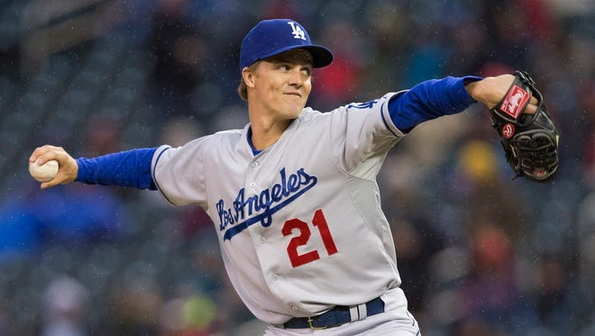 Los Angeles Dodgers starting pitcher Zack Greinke (21) delivers a pitch in the first inning against the Minnesota Twins.