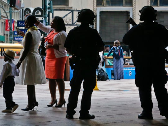 "A New York Police Department anti-terror unit guard an entry area to Madison Square Garden as families arrive for a graduation ceremony, Tuesday May 23, 2017, in New York. The NYPD says it has tightened security at high-profile locations ""out of an abundance of caution"" following the deadly explosion in Manchester, England."