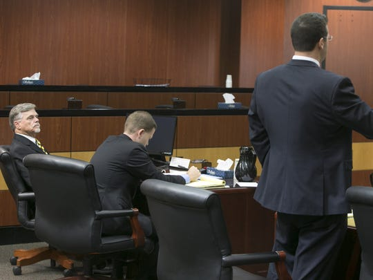 Attorneys for Steve Sussex (not pictured) Greg Robinson, (left) and Jack Wilenchik (center) look on as City of Tempe attorney Christopher Davis, (right) speaks to the judge in a case over a parcel of land near Tempe Town Lake.