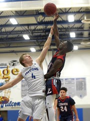 Lebanon Cedar Jahlil Young tries to toss a two point shot over Cedar Crest defender Logan Horn.
