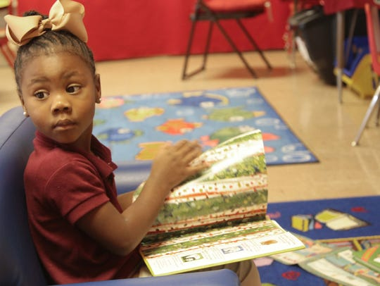 Pre-K student Ka'Leace Wesley finds a comfortable chair