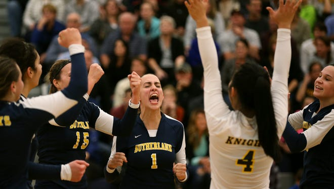 Sutherland's Mary Bayer (1) celebrates with teammates after beating Victor in the Class A State Qualifier.